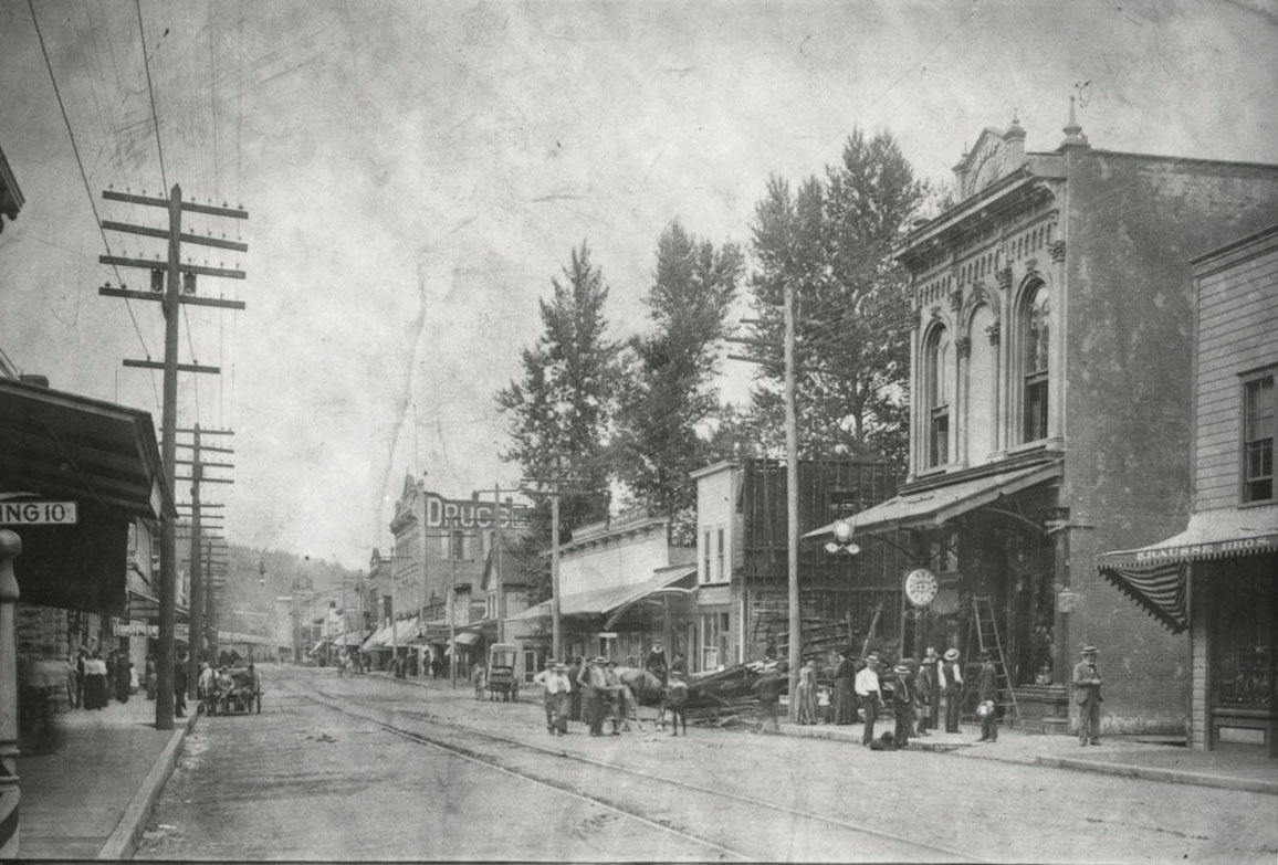 Main Street, looking south from Sixth Ave., Odd Fellows building on right, 1892