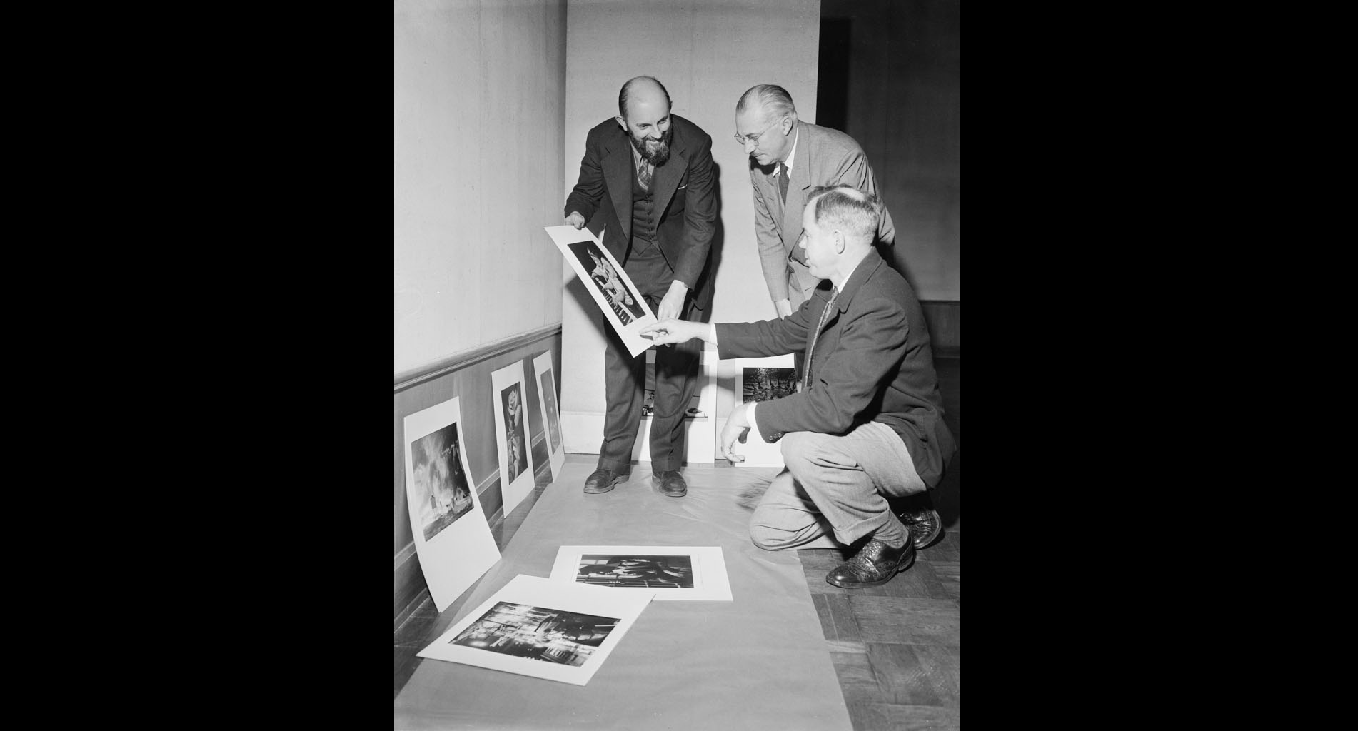 Ansel Adams, Rene Weaver, and Minor White, (left to right), judge photos for an exhibition, Portland Art Museum, 1951.