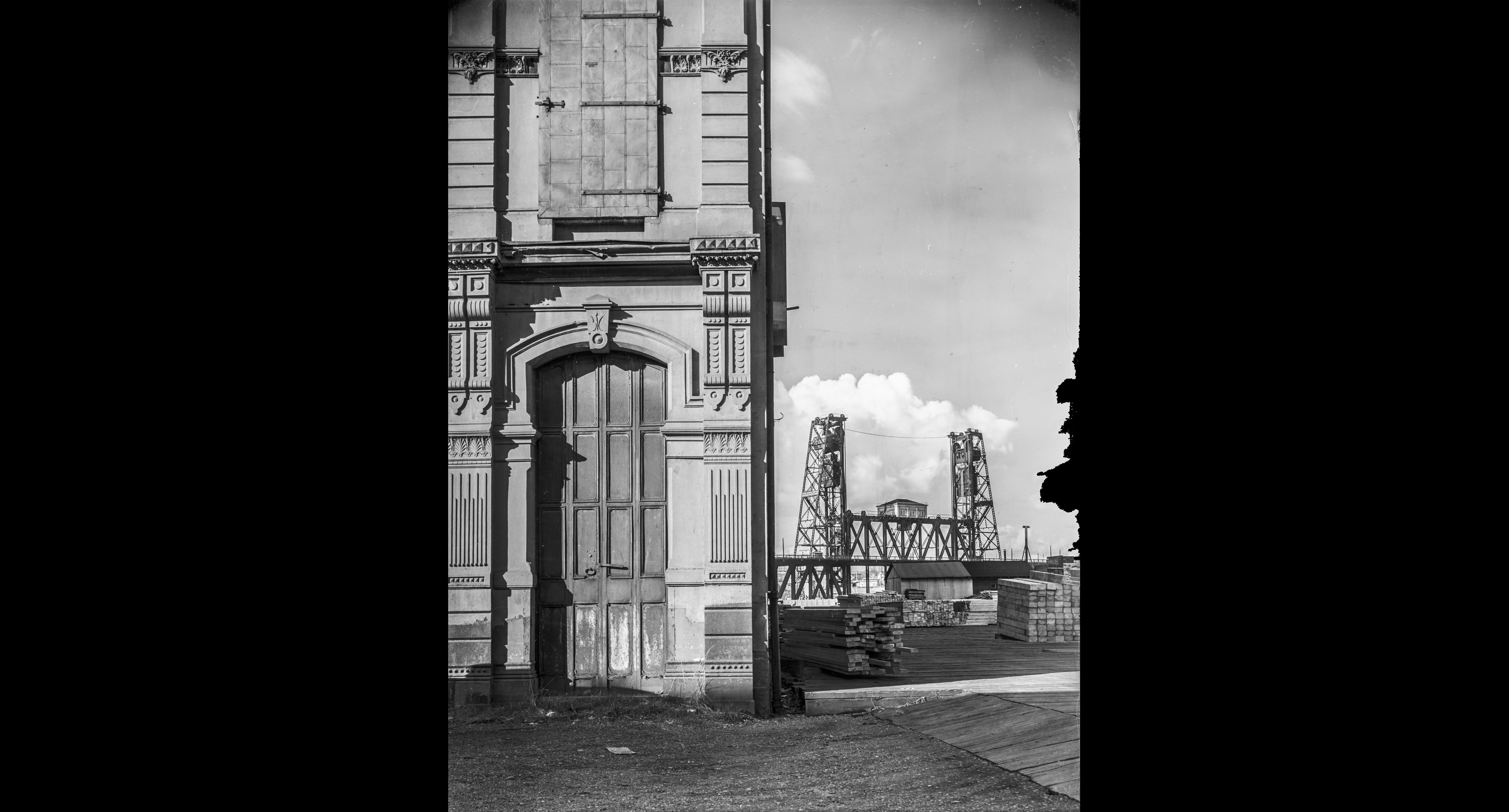 Southeast corner of Allen & Lewis Block, with Steel Bridge, March 8, 1939