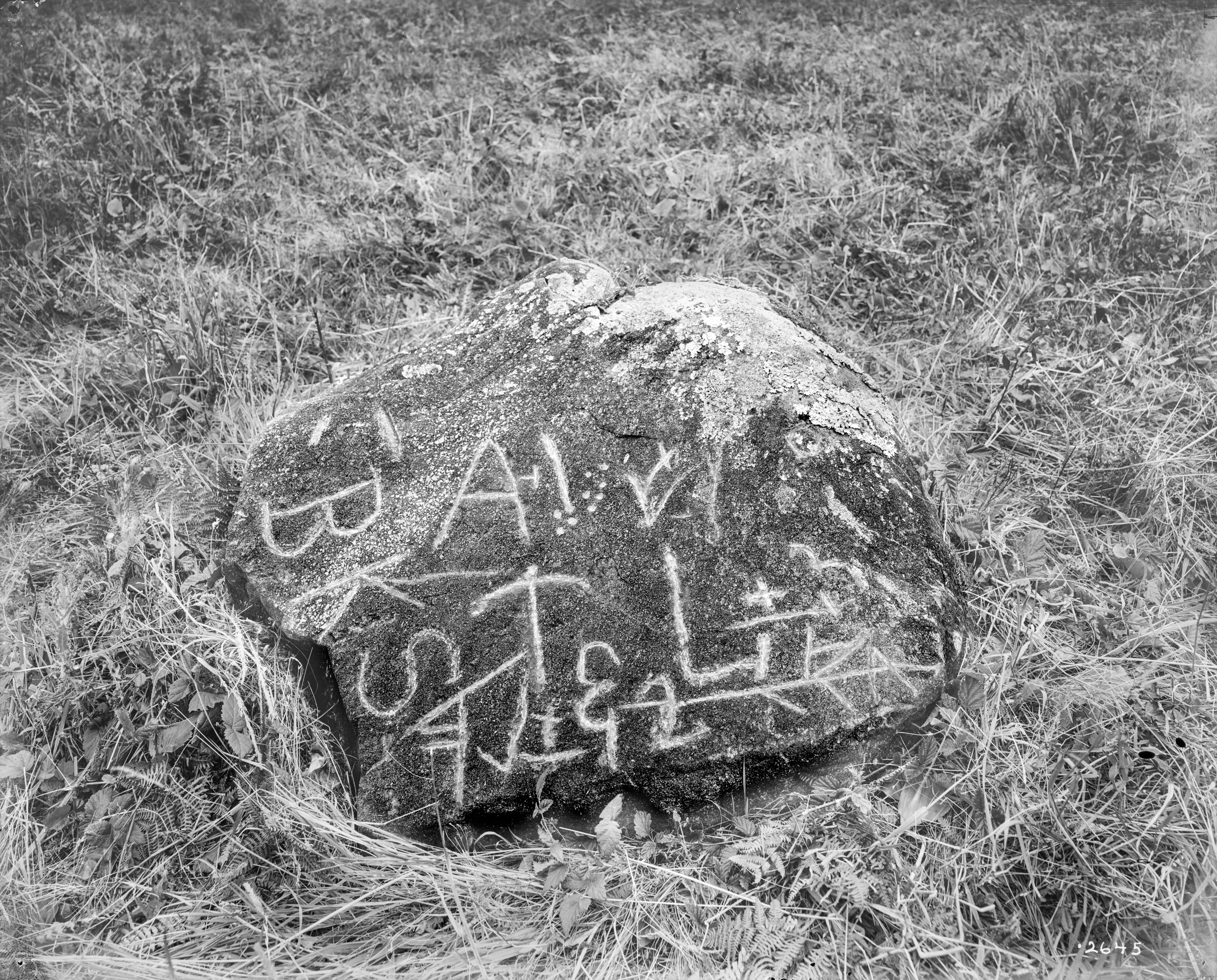 "The ""BKS rock,"" a marked stone found in the Neahkahnie area."