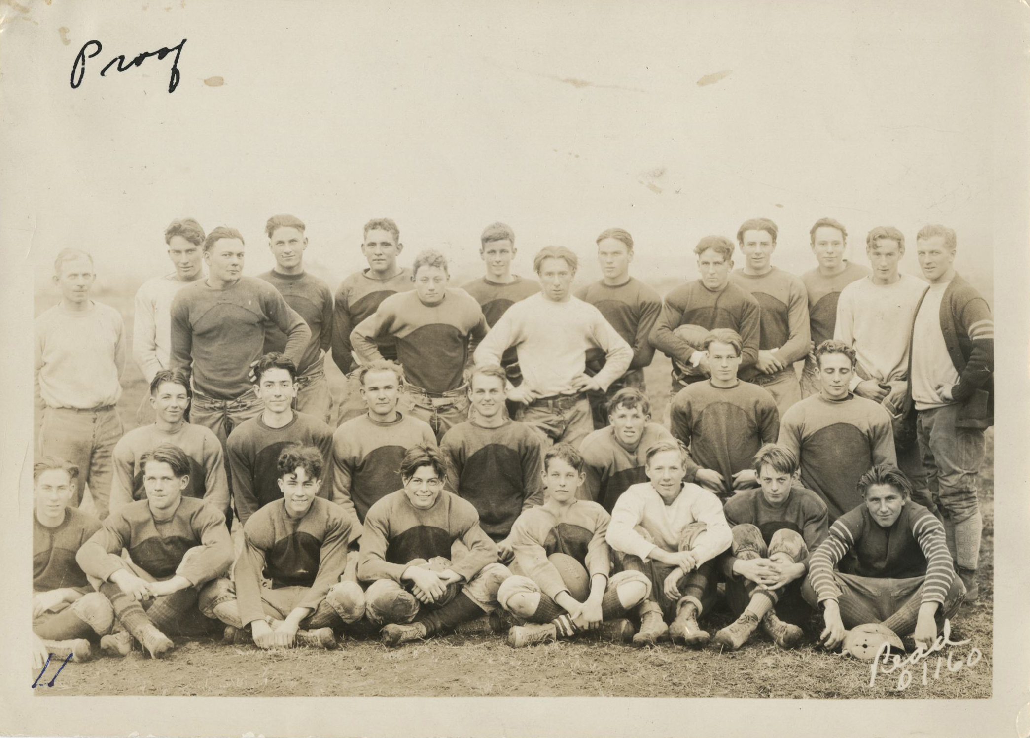 McCall on school football team, front, 4th from right