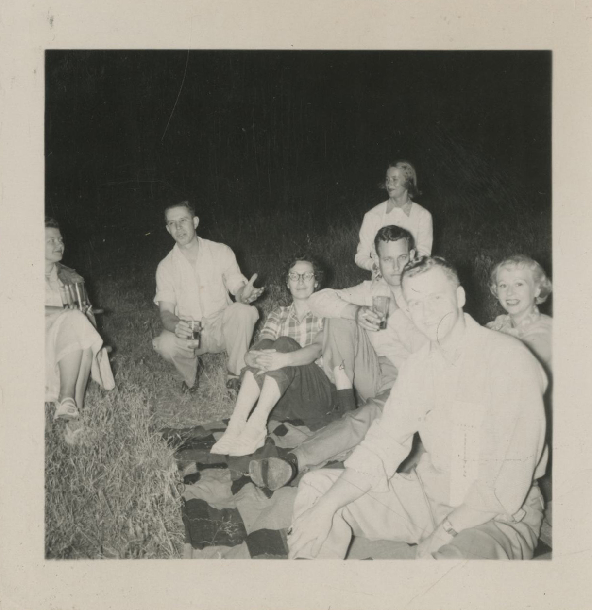 McCall, seated center, with friends