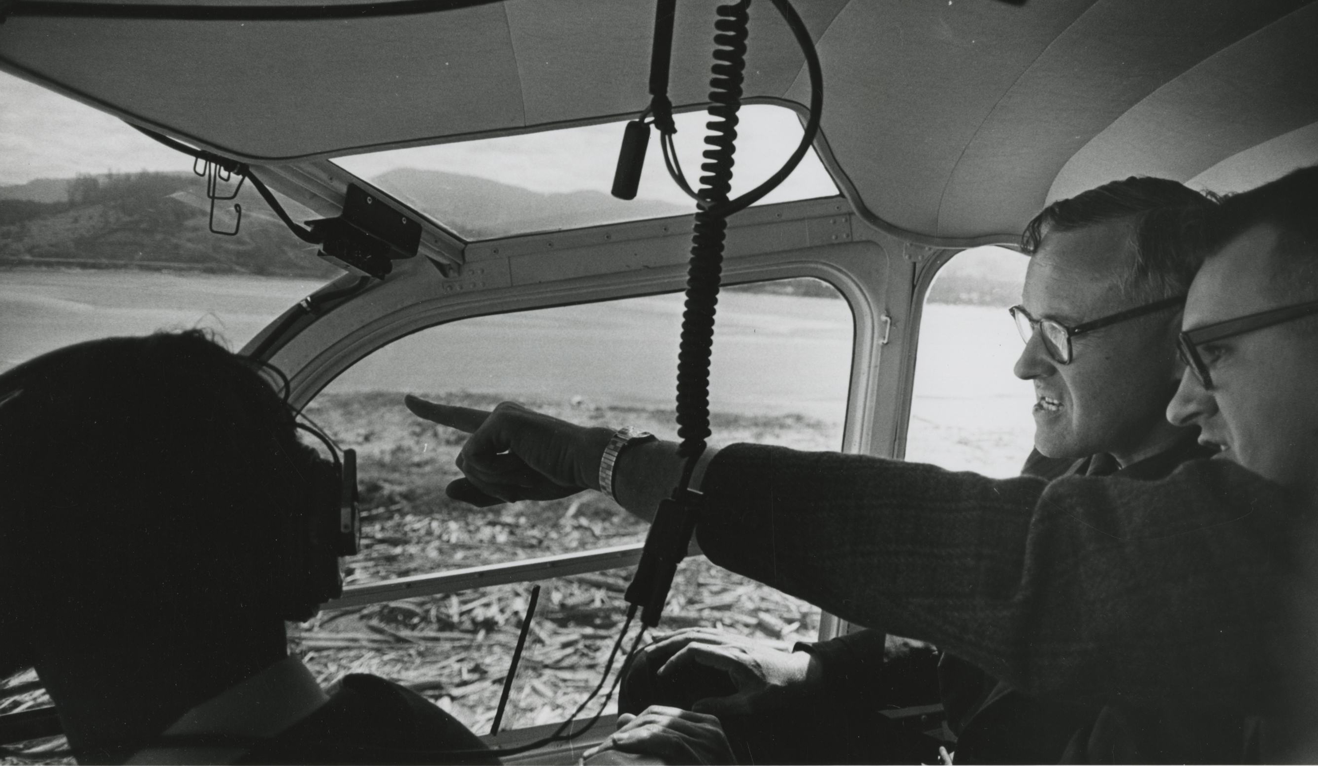 McCall in a helicopter flying over Oregon beaches, 1967