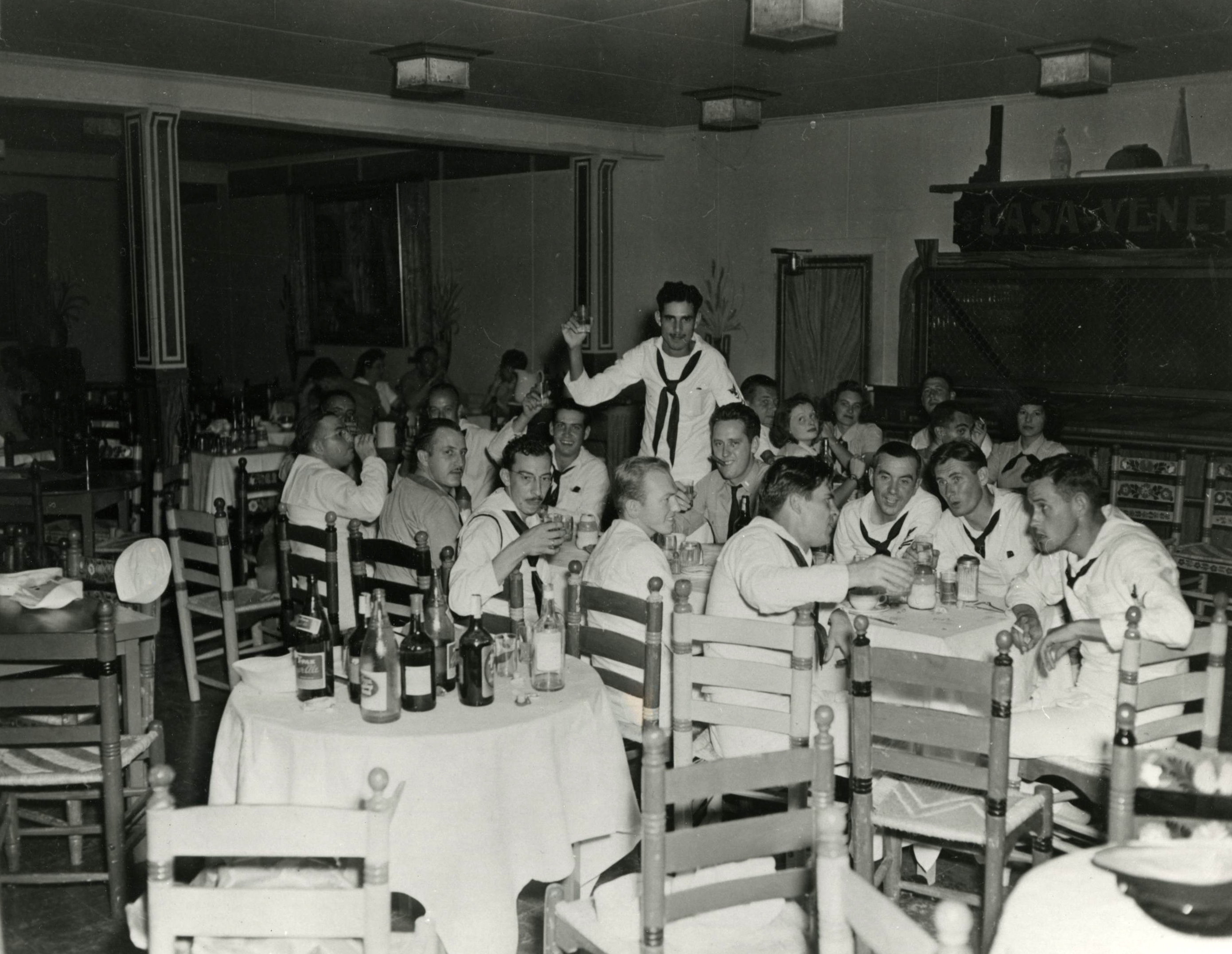 Tom McCall in the navy, seated far right