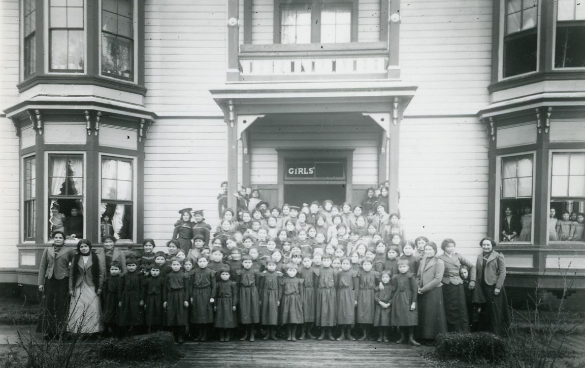 Students in front of the girls' dorm, Chemawa, 1887. Courtesy Oregon Hist. Soc. Research Lib., 0173G013.