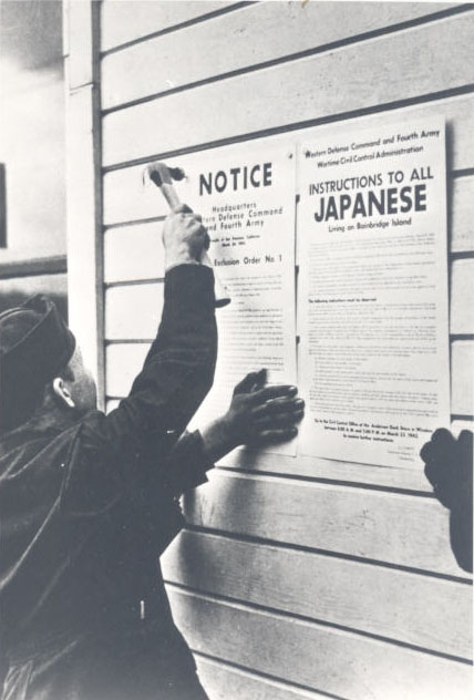 Soldier posting Civilian Exclusion Order #1, 1942