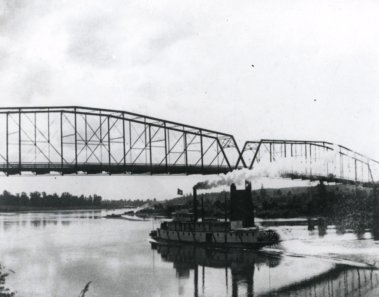 Steamboat passing under the Center Street Bridge over the Willamette, Salem