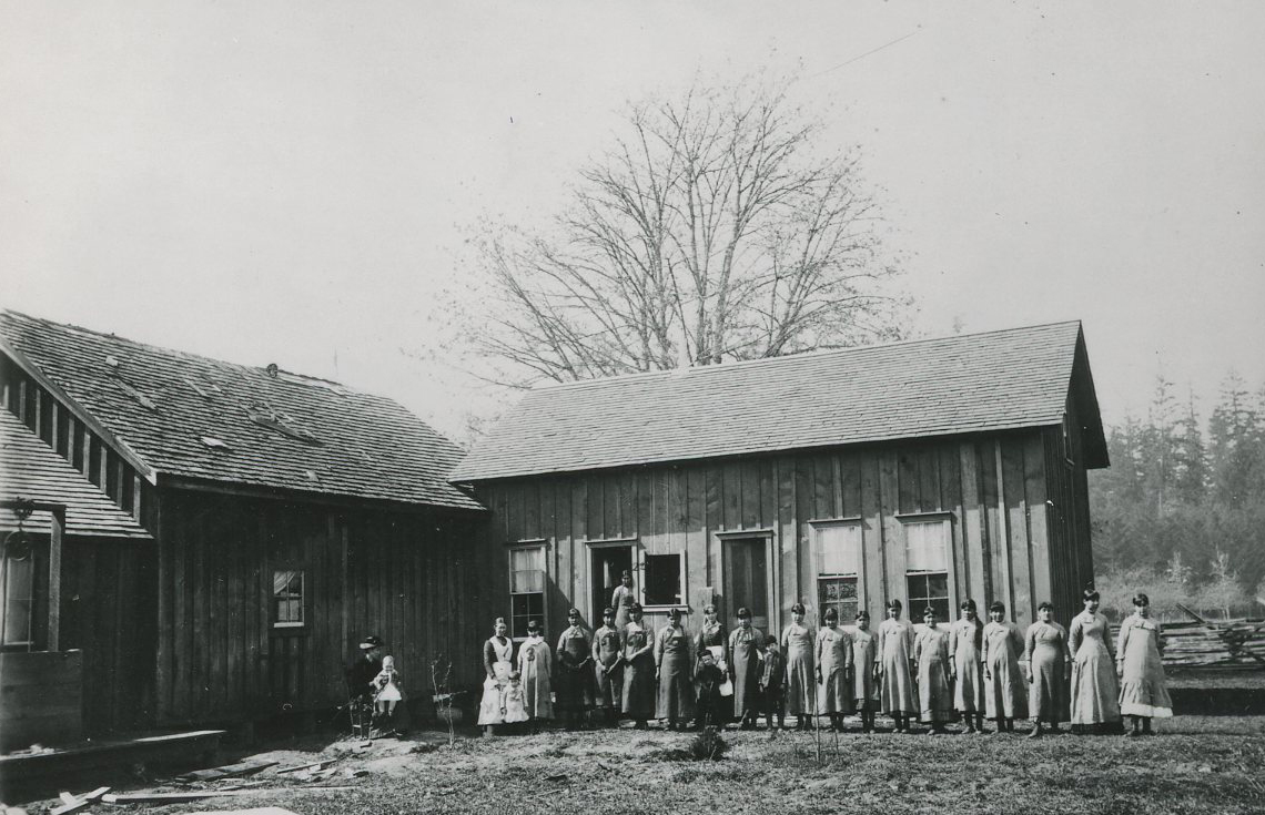 "Temporary buildings at Chemawa, with ""kitchen girls,"" 1885. Courtesy Oregon Hist. Soc. Research Lib., 015536."