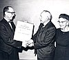 Charles Davis presents ACLU award to Gov. Sprague, 1962. Blanche Sprague stands to the right.