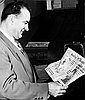 Senator Joseph McCarthy with editorial cartoon on front page of the Oregon Journal newspaper.