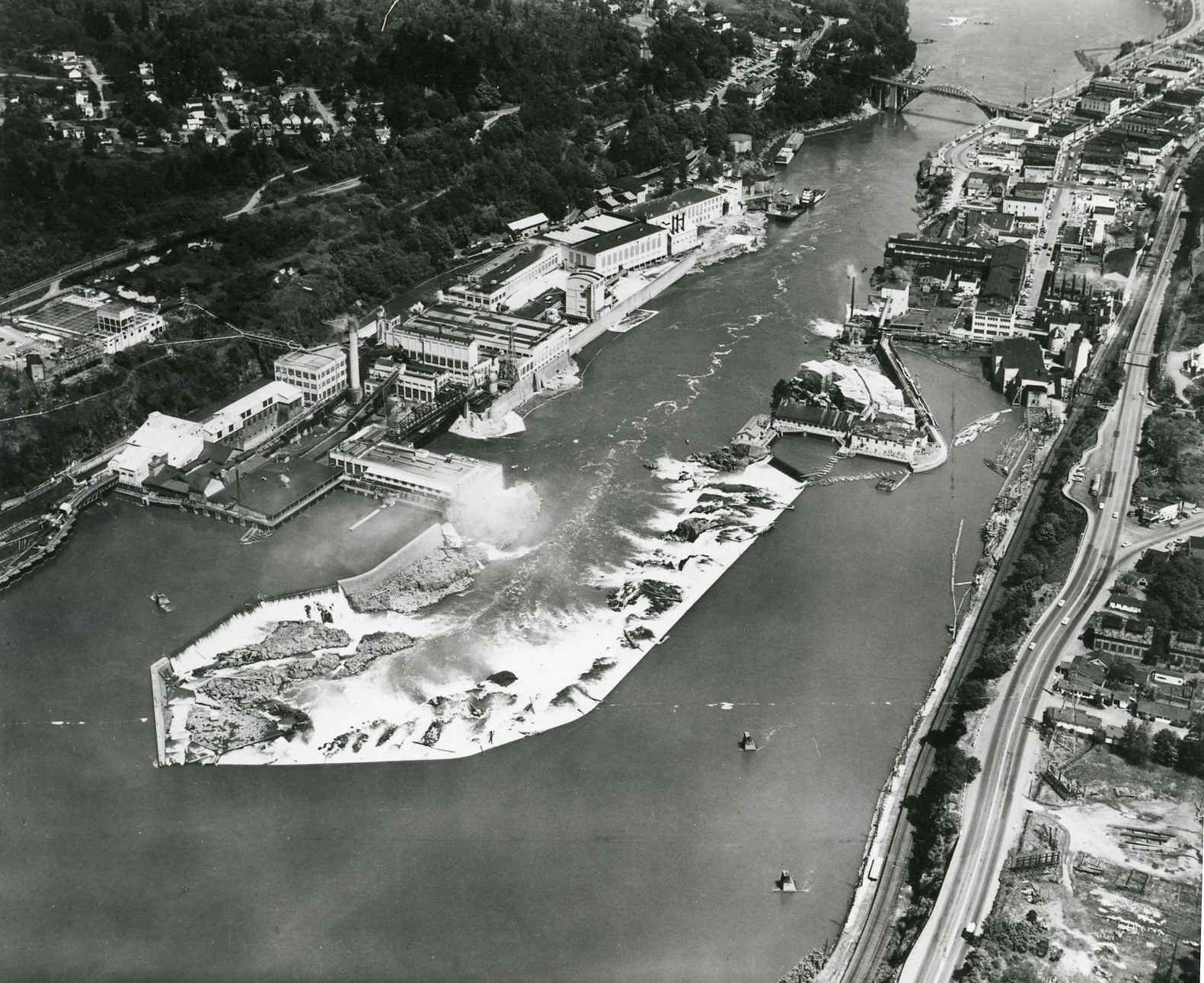 An aerial view of Willamette Falls, with West Linn on the left and Oregon City on the right. The mill belonged to Crown Zellerbach.